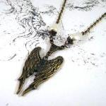 Bronzed angel wings necklac..