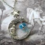 Antiqued silver moon and st..