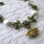Antiqued gold bee bracelet ..