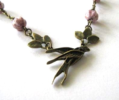Swallow necklace jewelry with leaves and light purple Czech melon glass beads