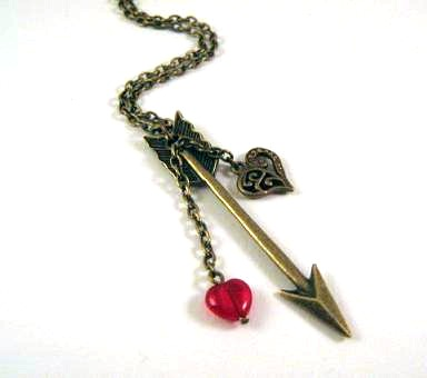 Bronzed arrow necklace jewelry with heart charm and red heart glass bead