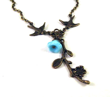 Bronzed flower branch necklace jewelry with blue flower and swallow birds