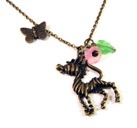 Zebra necklace jewelry with pink flower and green leaf - Antiqued bronze butterfly necklace