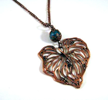 Simple copper leaf necklace jewelry with teal colored glass bead