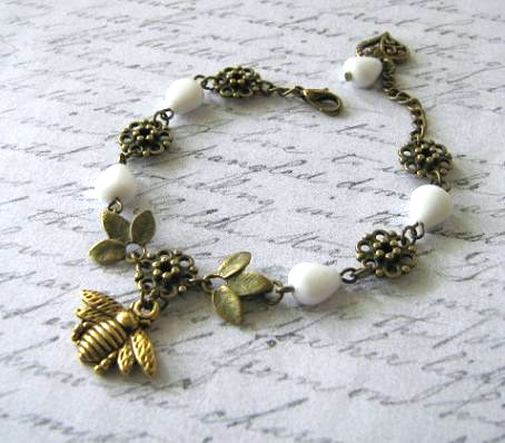 Antiqued gold bee bracelet Czech white beads jewelry leaves and heart charms