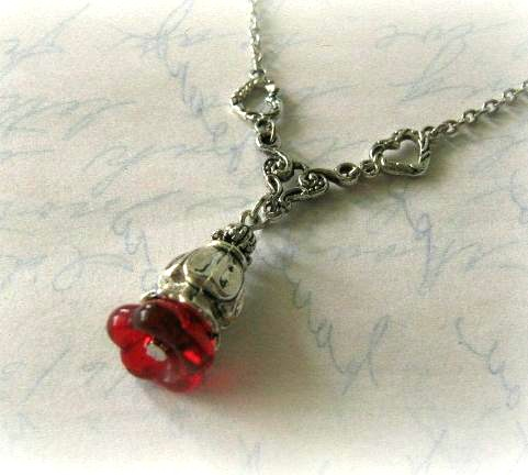 Red flower bud necklace jewelry with antiqued silver heart charms