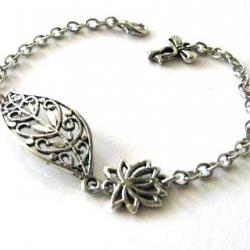 Antiqued silver filigree leaf bracelet jewelry with lotus flower and bow charm